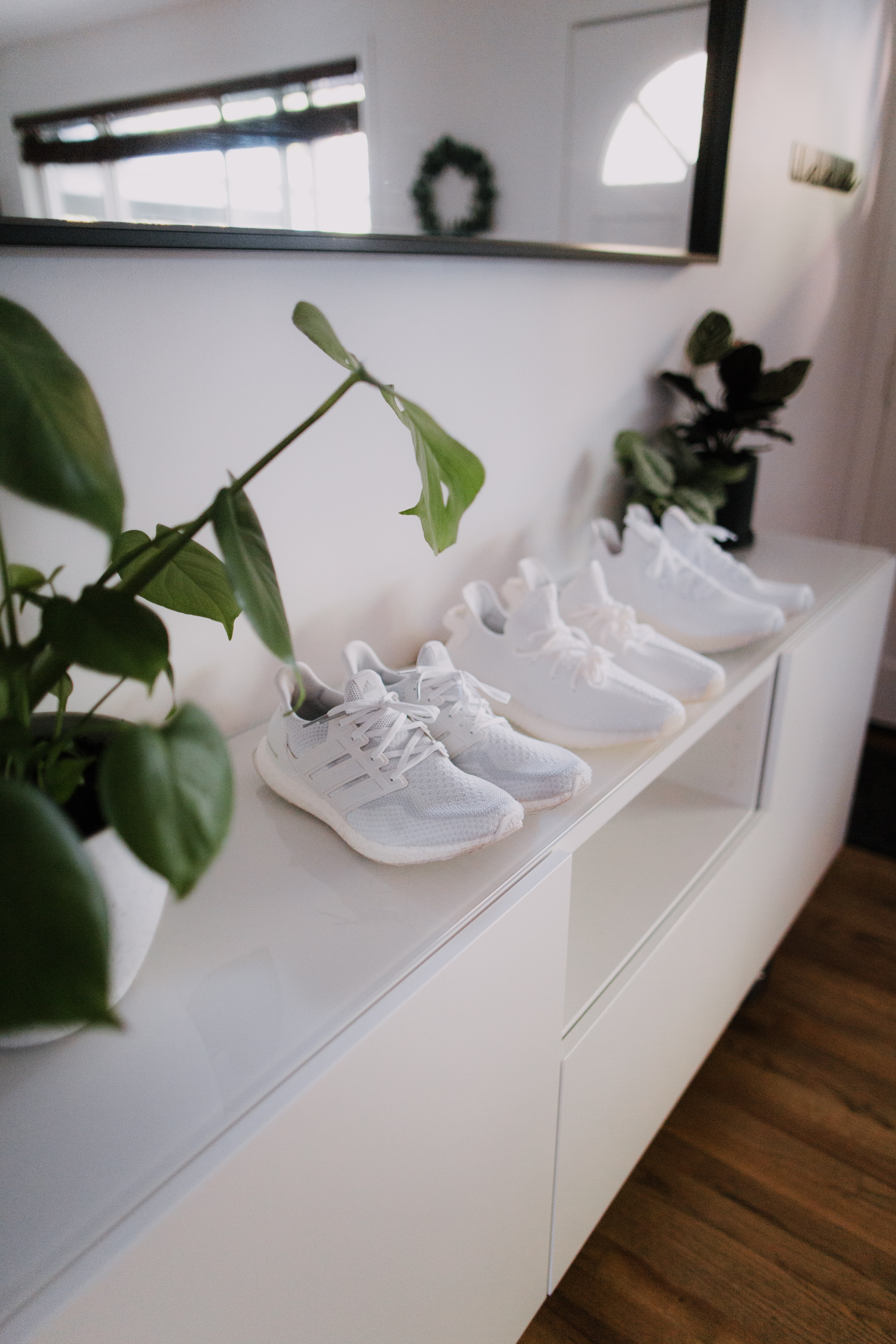 white nike air force 1 shoes on white wooden table